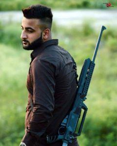Shehbaz-Badesha-with-a-gun